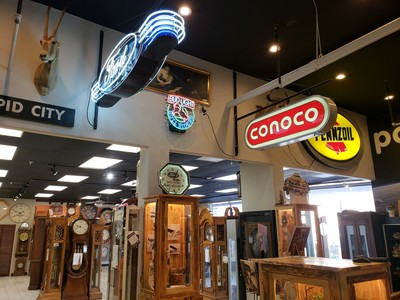 Antique signs and grandfather clocks at Presidential Pawn.