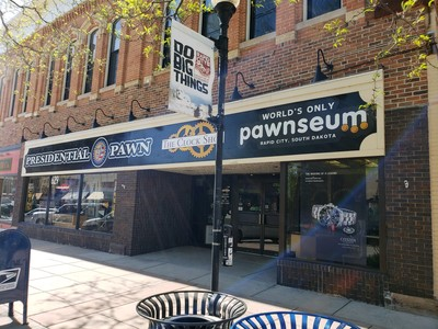 Store front for Presidential Pawn, The Clock Shop, and the World's Only Pawnseum