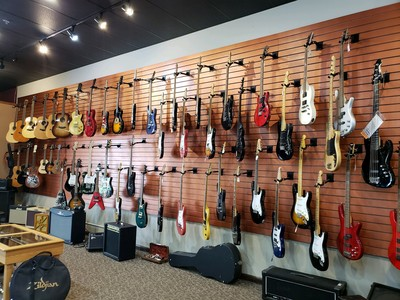 Acoustic and electric guitars at Presidential Pawn